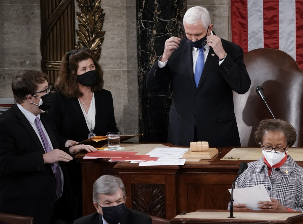 In this Jan. 6, 2021, photo, Senate Parliamentarian Elizabeth MacDonough, left, works beside Vice President Mike Pence during the certification of Ele...