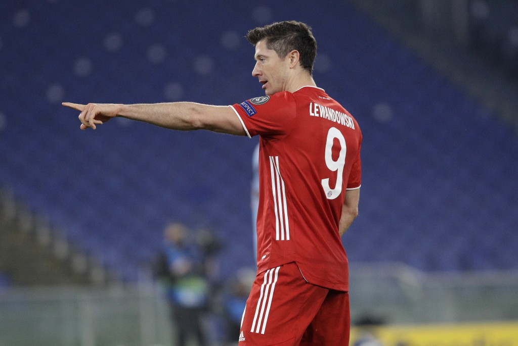 Bayern's Robert Lewandowski celebrates after scoring his side's opening goal during the Champions League round of 16 first leg soccer match between La...