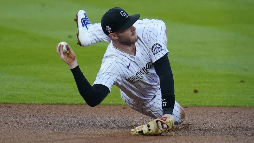 FILE - wldColorado Rockies shortstop Trevor Story throws after fielding a ground ball against the Los Angeles Angels in the first inning of a baseball...