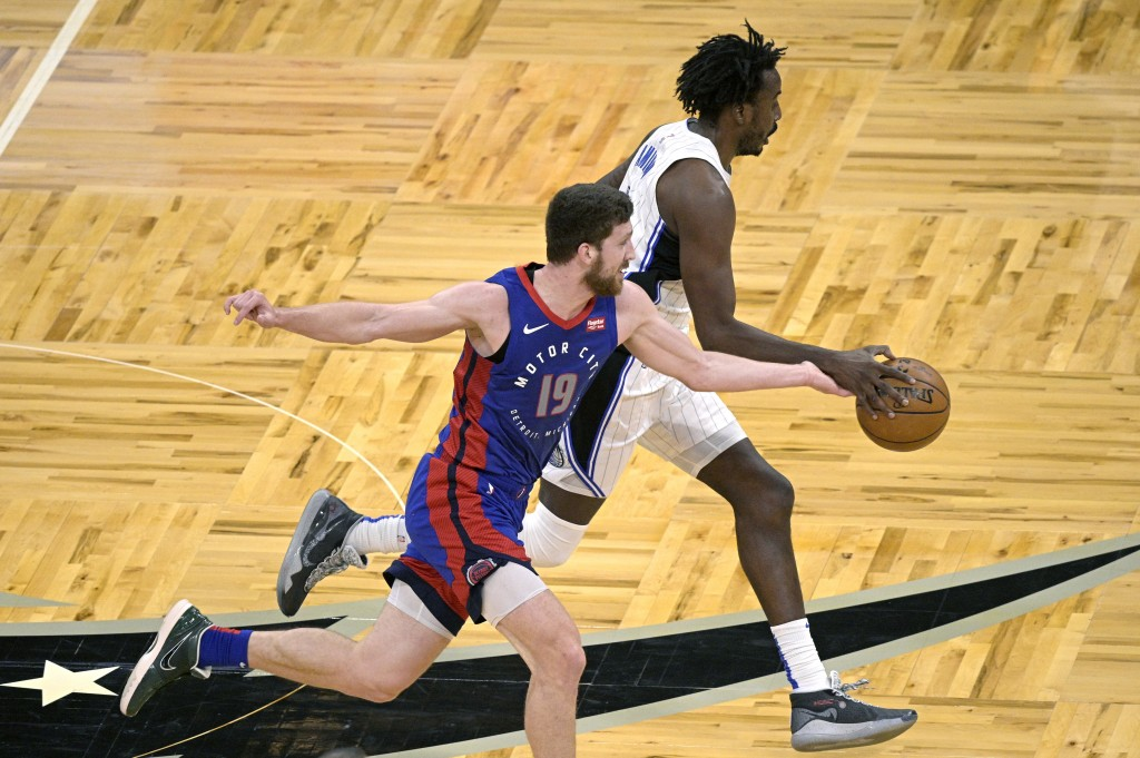 Detroit Pistons guard Svi Mykhailiuk (19) pokes the ball away from Orlando Magic forward Al-Farouq Aminu, right, during the second half of an NBA bask...