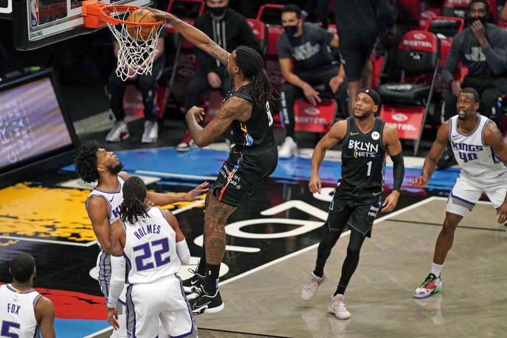 Brooklyn Nets center DeAndre Jordan (6) dunks in front of Brooklyn Nets guard Bruce Brown (1) and Sacramento Kings forward Harrison Barnes (40) as Kin...