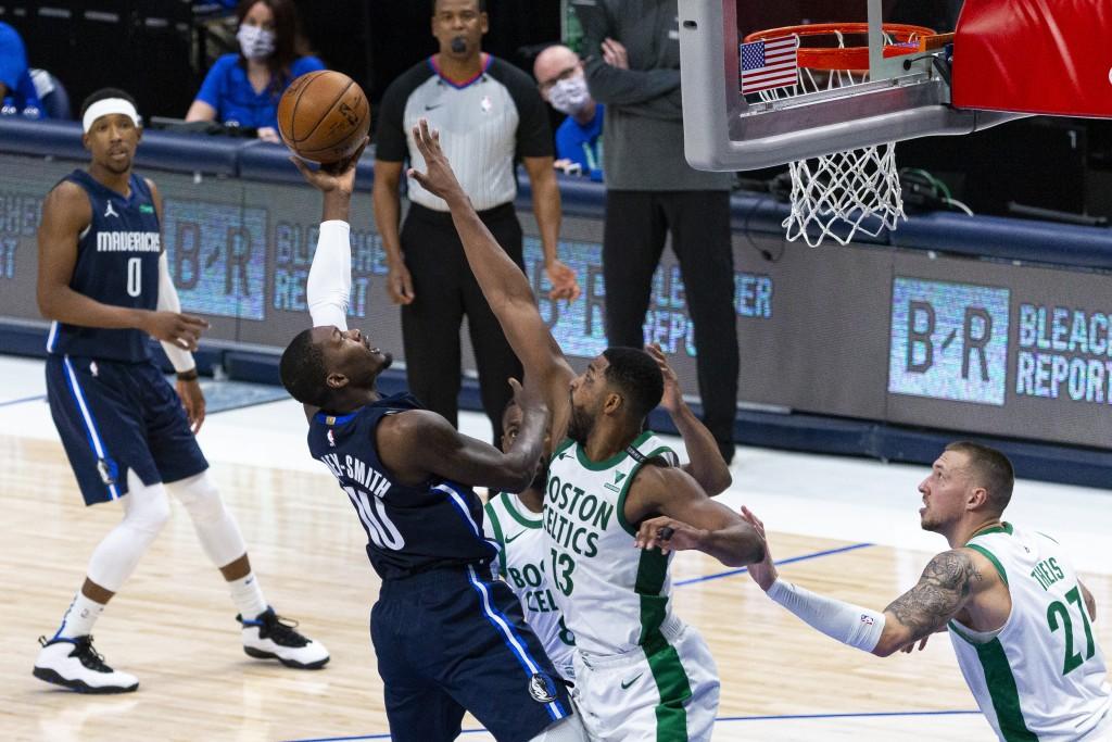 Dallas Mavericks forward Dorian Finney-Smith (10) shoots as Boston Celtics forward Tristan Thompson (13) defends during the second half of an NBA bask...
