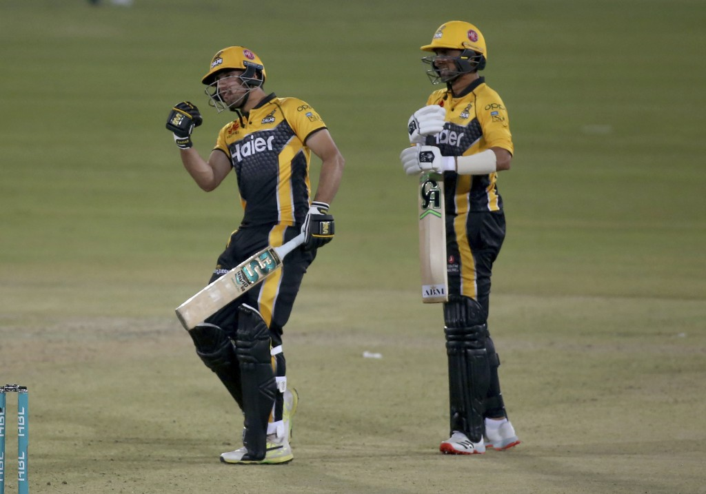 Peshawar Zalmi Haider Ali, left, celebrates after playing winning score while teammate Shoaib Malik watches during a Pakistan Super League T20 cricket...