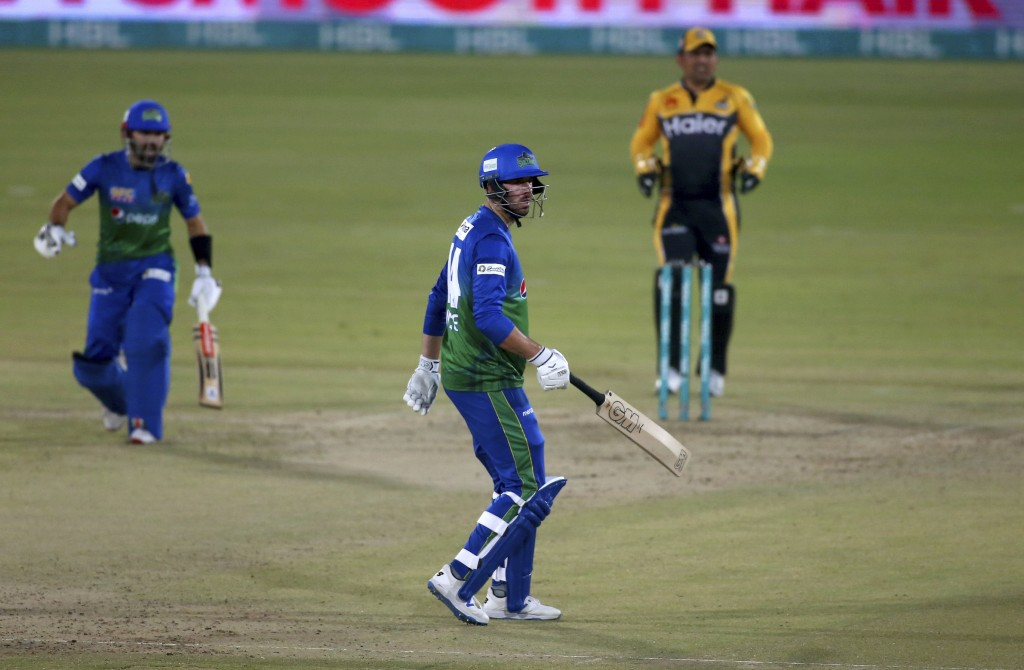 Multan Sultans' James Vince, center, follows the ball after playing a shot for boundary during a Pakistan Super League T20 cricket match between Multa...
