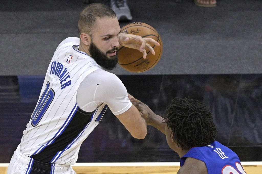 Orlando Magic guard Evan Fournier, left, is fouled by Detroit Pistons guard Saben Lee, right, while setting up for a shot during the second half of an...