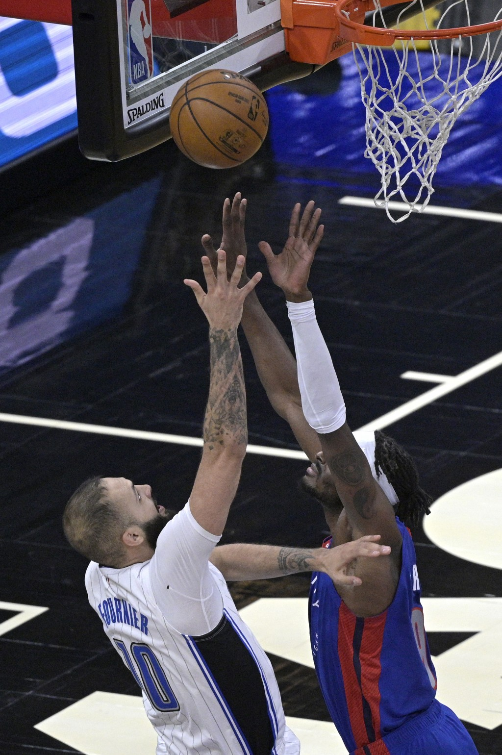 Orlando Magic guard Evan Fournier, left,  is fouled by Detroit Pistons forward Jerami Grant, right, while going up for a shot during the first half of...