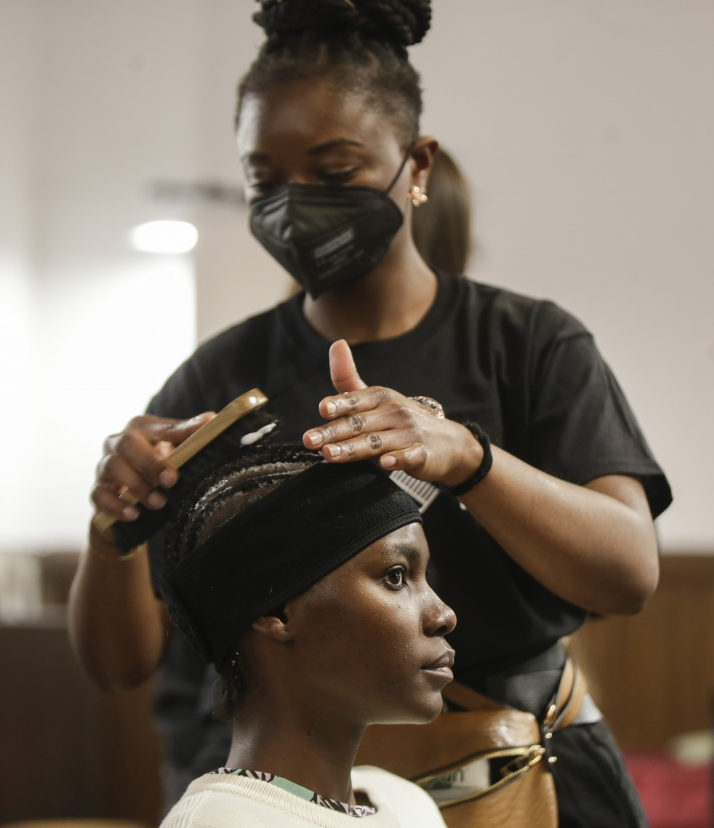 A model gets her make-up done in the backstage prior to the start of the Black Lives Matter Fall/Winter 2021/22 collective fashion show, presented in ...