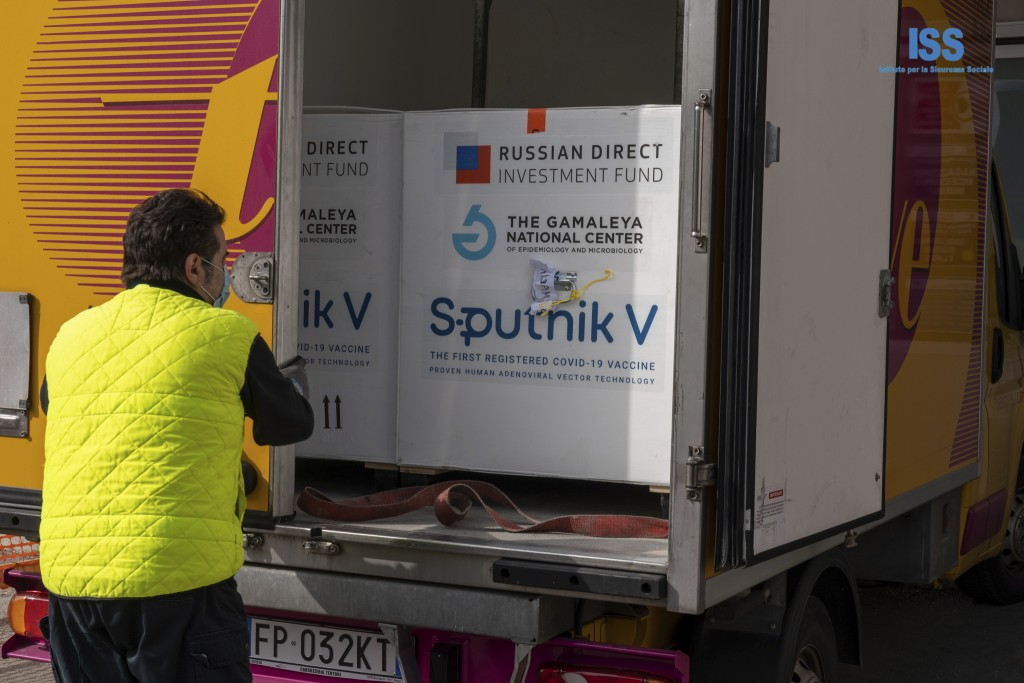 Boxes containing Russian vaccine Sputnik V are unloaded in San Marino, Tuesday, Feb. 23, 2021.The Republic of San Marino, a city state surrounded by I...