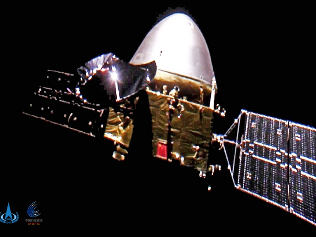 FILE - This file image made available by the China National Space Administration on Wednesday, Dec. 16, 2020, shows the Tianwen-1 probe en route to Ma...