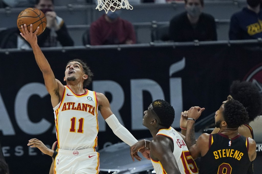 Atlanta Hawks' Trae Young (11) drives to the basket in the first half of an NBA basketball game against the Cleveland Cavaliers, Tuesday, Feb. 23, 202...
