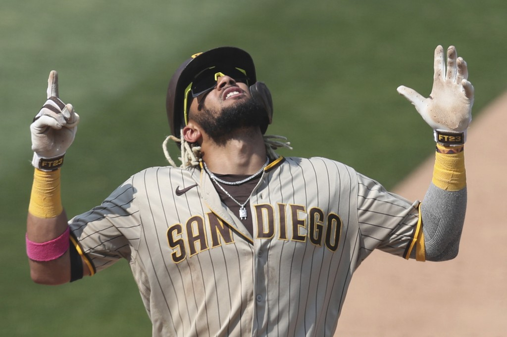 FILE - San Diego Padres' Fernando Tatis Jr. celebrates after hitting a solo home run against the Oakland Athletics during the seventh inning of a base...