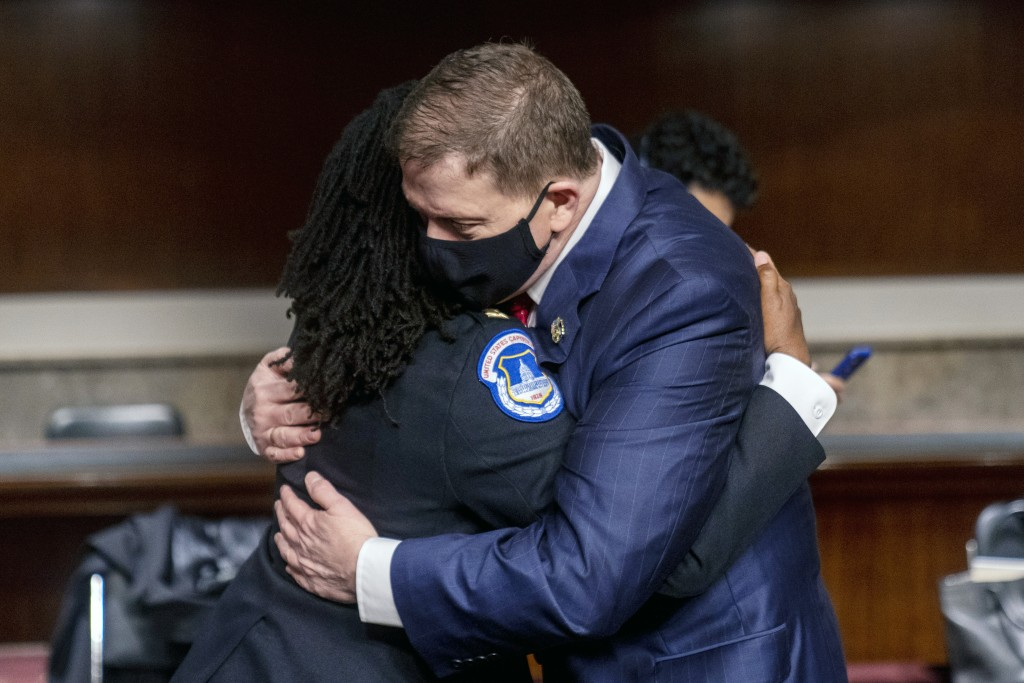 Former U.S. Capitol Police Chief Steven Sund, right, hugs Capitol Police Captain Carneysha Mendoza, left, before they testify before a Senate Homeland...