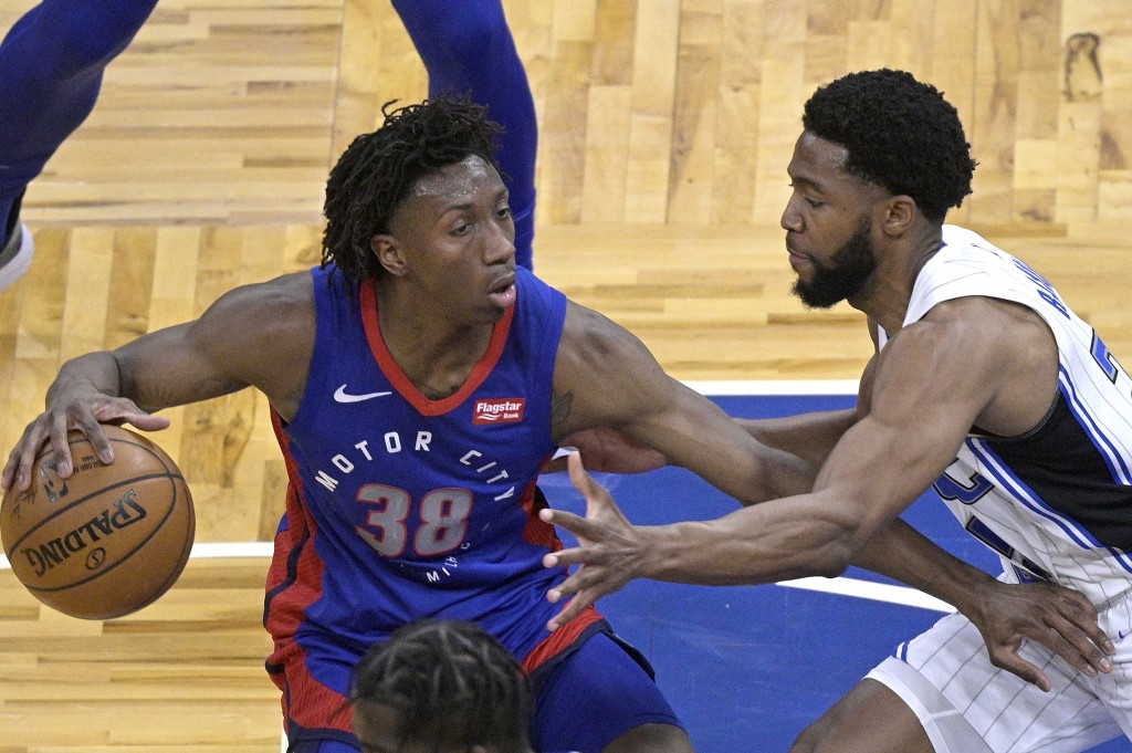 Detroit Pistons guard Saben Lee (38) sets up for a shot in front of Orlando Magic guard Chasson Randle (25) during the first half of an NBA basketball...