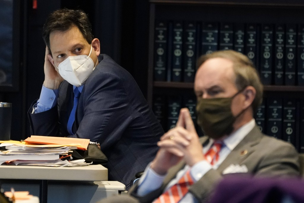 Virginia State Sen. Scott Surovell, D-Fairfax, left, listens along with Sen. Lynwood Lewis, D-Accomack, right, during debate on a bill calling for the...