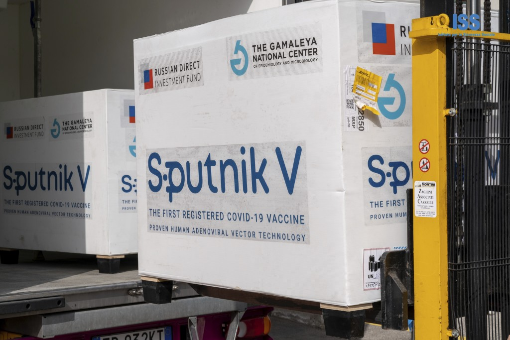 Boxes containing Russian vaccine Sputnik V are unloaded in San Marino, Tuesday, Feb. 23, 2021. The Republic of San Marino, a city state surrounded by ...