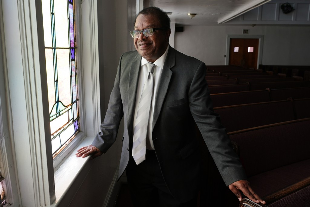 Rev. Timothy McDonald III poses for a portrait at First Iconium Baptist Church, Monday, Feb. 22, 2021, in Atlanta. After record turnout led to stunnin...
