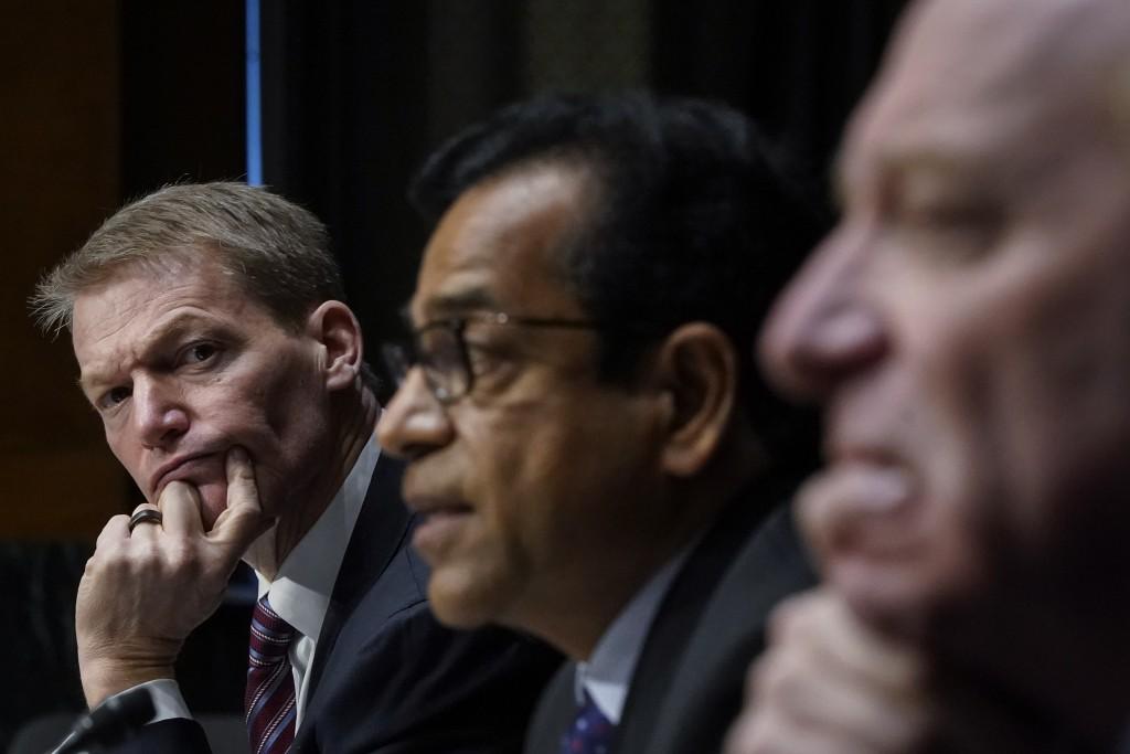 FireEye CEO Kevin Mandia, SolarWinds CEO Sudhakar Ramakrishna and Microsoft President Brad Smith testify during a Senate Intelligence Committee hearin...
