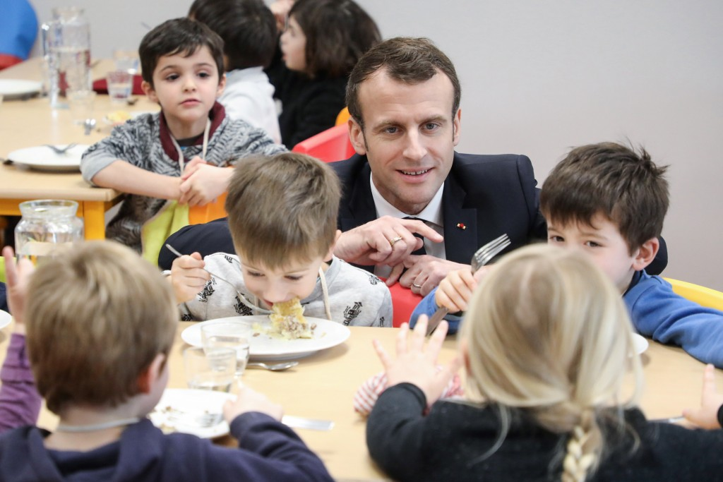 FILE - In this Jan.18, 2019 file photo, French President Emmanuel Macron meets pupils as he visits a school canteen in Saint-Sozy, southwestern France...