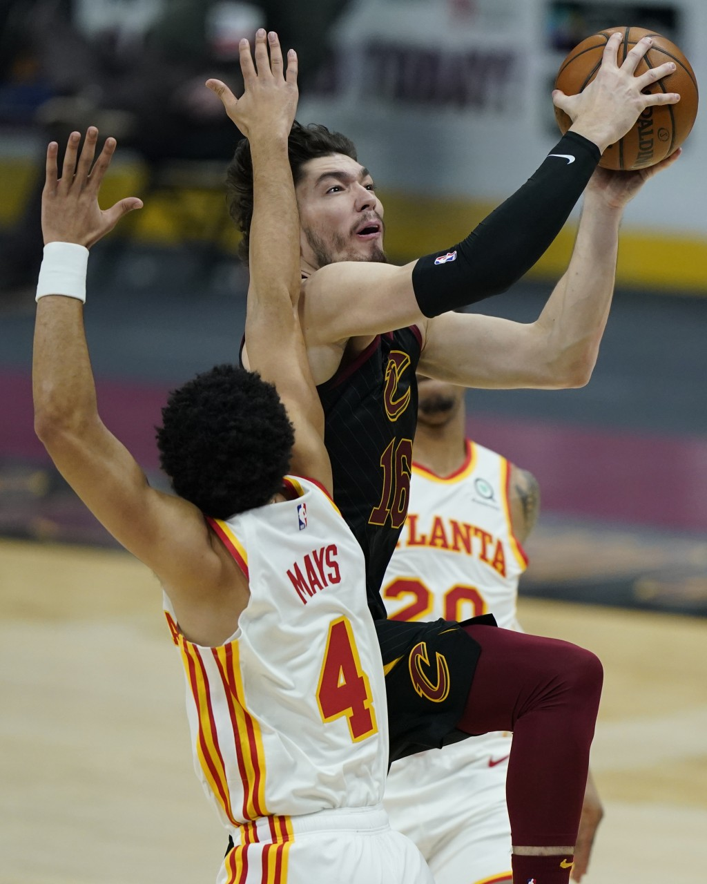 Cleveland Cavaliers' Cedi Osman (16) drives to the basket against Atlanta Hawks' Skylar Mays (4) in the first half of an NBA basketball game, Tuesday,...