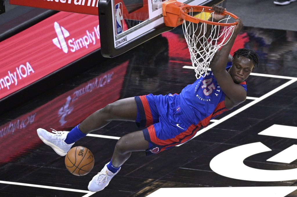 Detroit Pistons forward Sekou Doumbouya (45) dunks the ball during the second half of an NBA basketball game against the Orlando Magic, Tuesday, Feb. ...