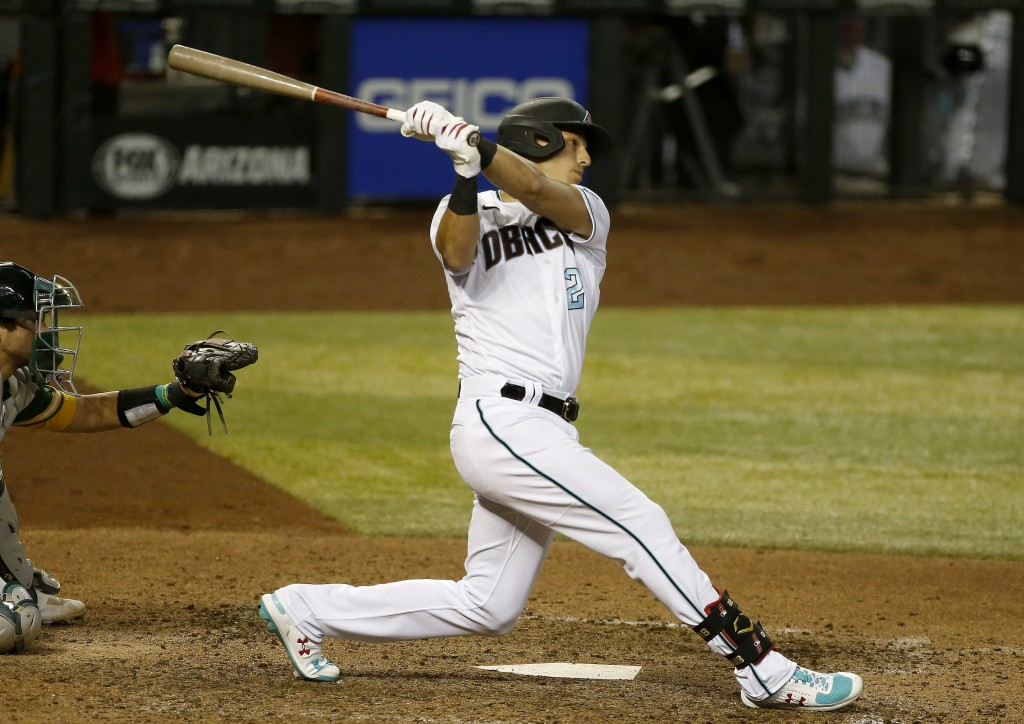 FILE - Arizona Diamondbacks' Jake Lamb swings at a pitch during the seventh inning of a baseball game against the Oakland Athletics in Phoenix, in thi...
