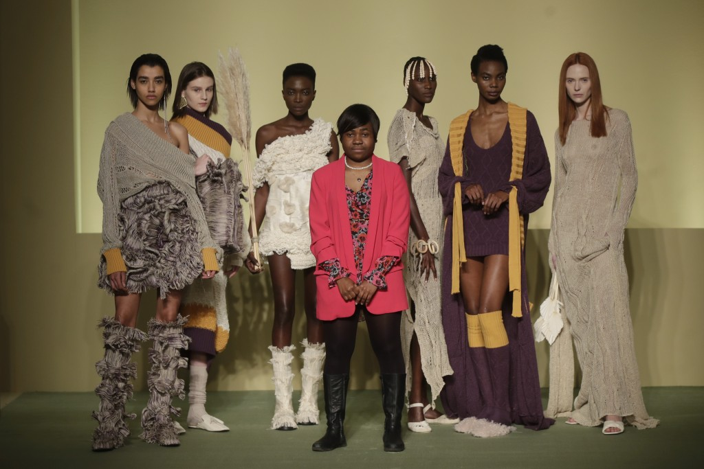 Fashion designer Gisele Claudia Ntsama poses with models during the Black Lives Matter Fall/Winter 2021/22 collection collective show, presented in Mi...