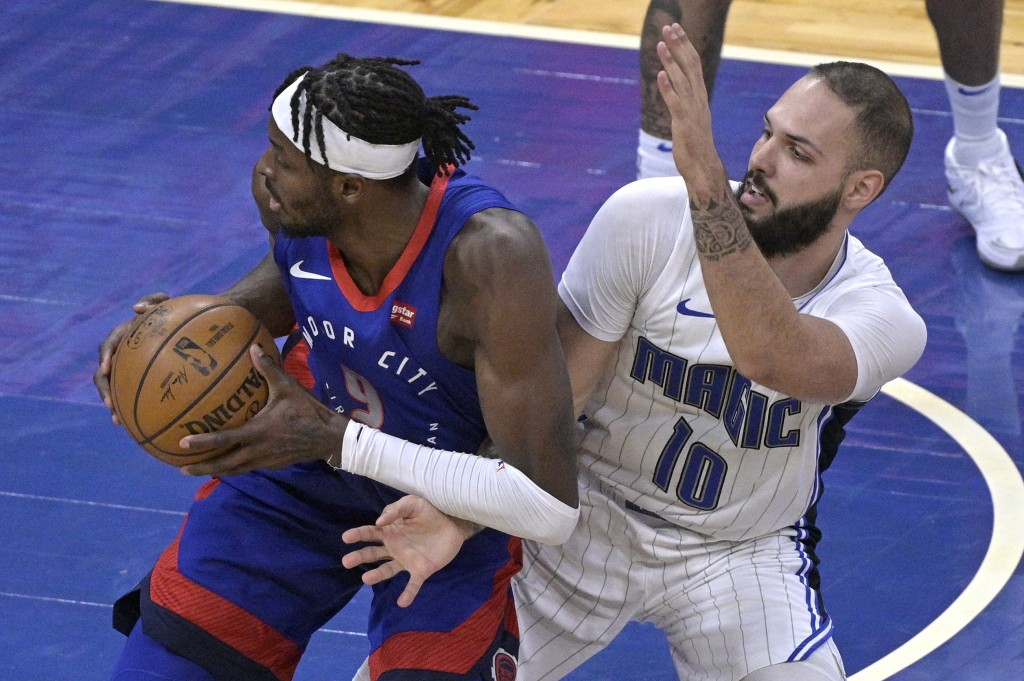 Detroit Pistons forward Jerami Grant (9) spins to the basket while defended by Orlando Magic guard Evan Fournier (10) during the second half of an NBA...