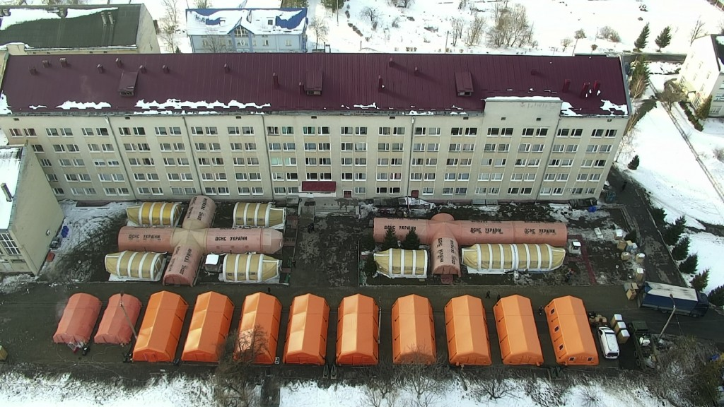 In this photo released by Ukraine's Emergency Situation Ministry on Feb. 20, 2021, a mobile hospital is set up in front of a regional hospital in the ...
