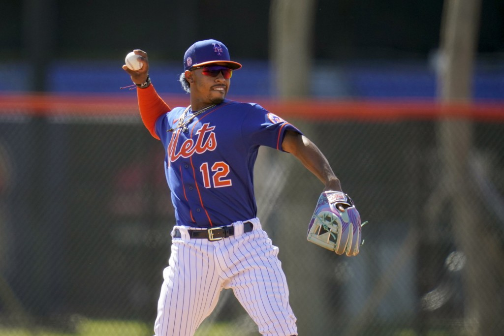 New York Mets infielder Francisco Lindor throws during spring training baseball practice Tuesday, Feb. 23, 2021, in Port St. Lucie, Fla. (AP Photo/Jef...