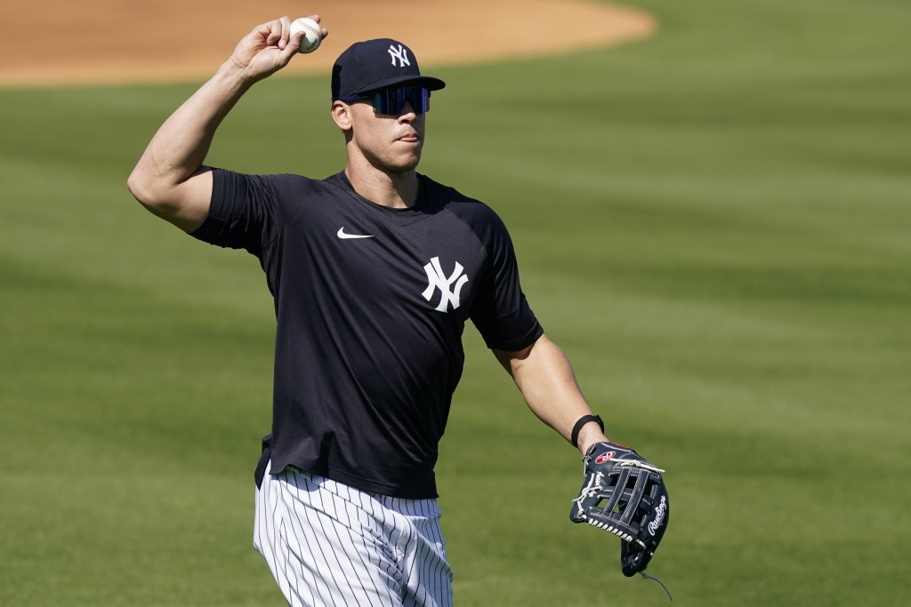 New York Yankees' Aaron Judge throws to a teammate during a spring training baseball workout, Tuesday, Feb. 23, 2021, in Tampa, Fla. (AP Photo/Frank F...