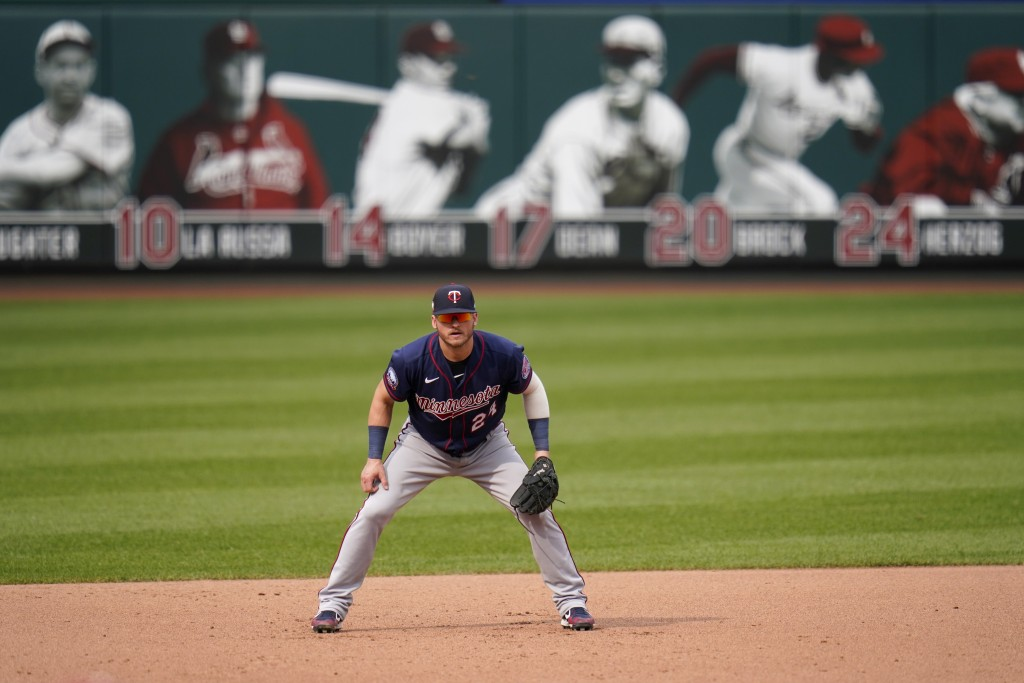 FILE - Minnesota Twins third baseman Josh Donaldson takes up his position during the fourth inning in the first game of a baseball doubleheader agains...