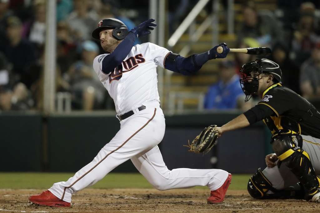 FILE - Minnesota Twins' Josh Donaldson follows through on a double as Pittsburgh Pirates catcher Andrew Susac looks on in the third inning of a spring...