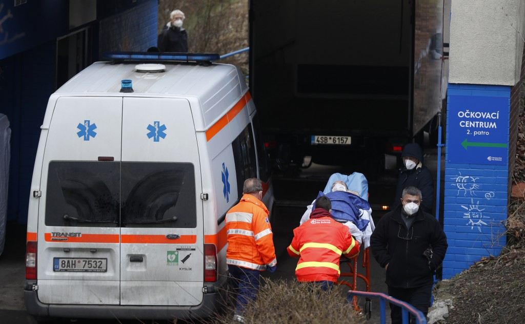 Healthcare workers move a patient to the infectious ward of the Bulovka hospital in Prague, Czech Republic, Wednesday, Feb. 24, 2021. The Czech prime ...