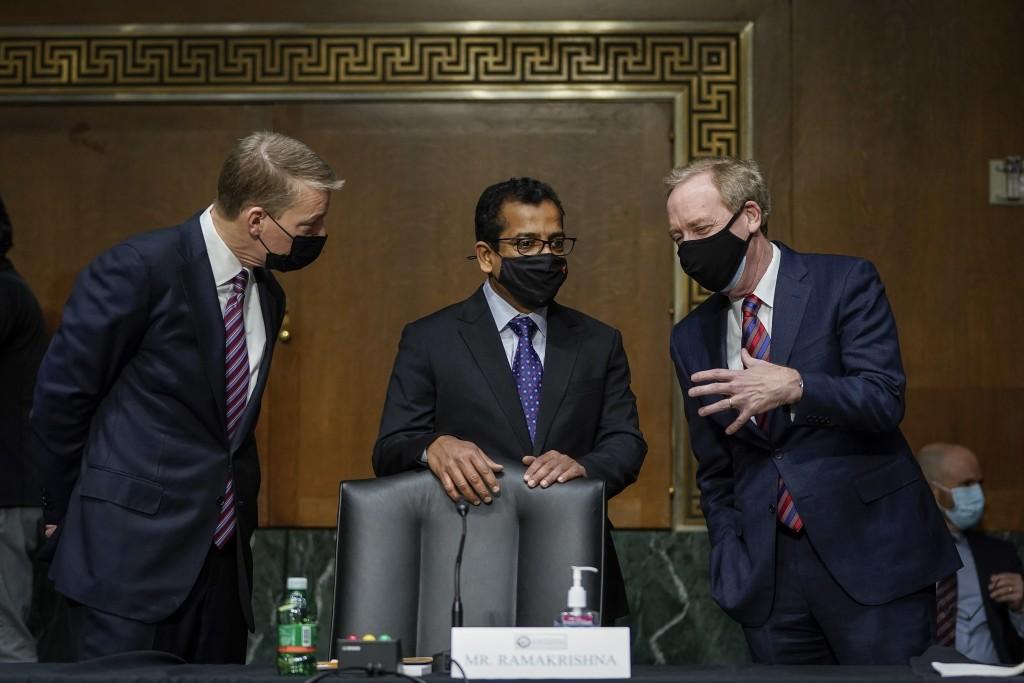 FireEye CEO Kevin Mandia, SolarWinds CEO Sudhakar Ramakrishna and Microsoft President Brad Smith talk before a Senate Intelligence Committee hearing o...