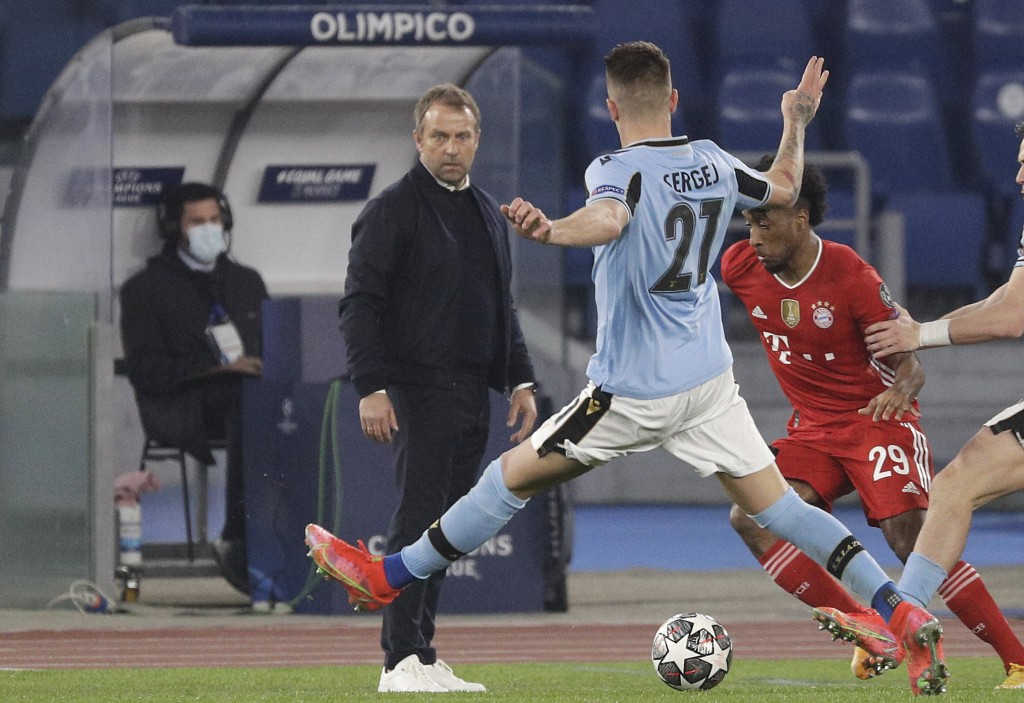 Bayern's head coach Hans-Dieter Flick, left, stands during the Champions League round of 16 first leg soccer match between Lazio and Bayern Munich at ...