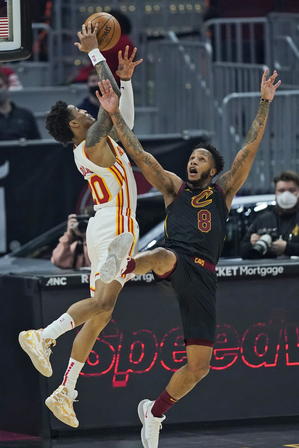Cleveland Cavaliers' Lamar Stevens (8) and Atlanta Hawks' John Collins (20) battle for a loose ball in the first half of an NBA basketball game, Tuesd...