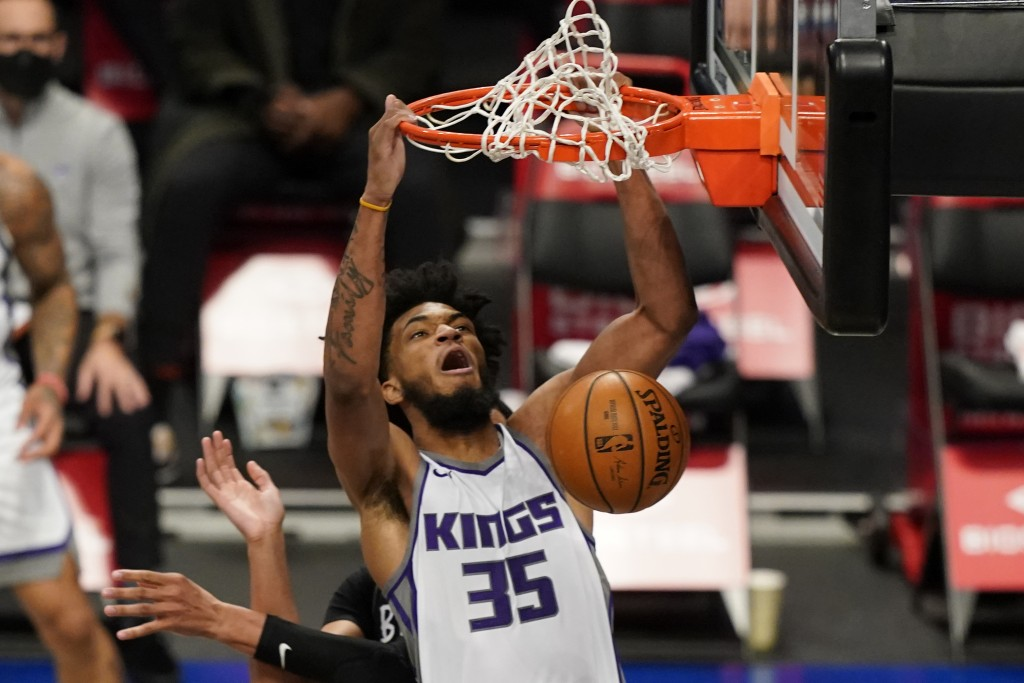 Sacramento Kings forward Marvin Bagley III (35) dunks during the first quarter of an NBA basketball game against the Brooklyn Nets, Tuesday, Feb. 23, ...