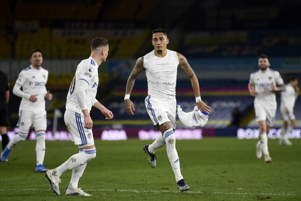 Leeds United's Raphinha, center, celebrates after scoring his side's third goal during the English Premier League soccer match between Leeds United an...