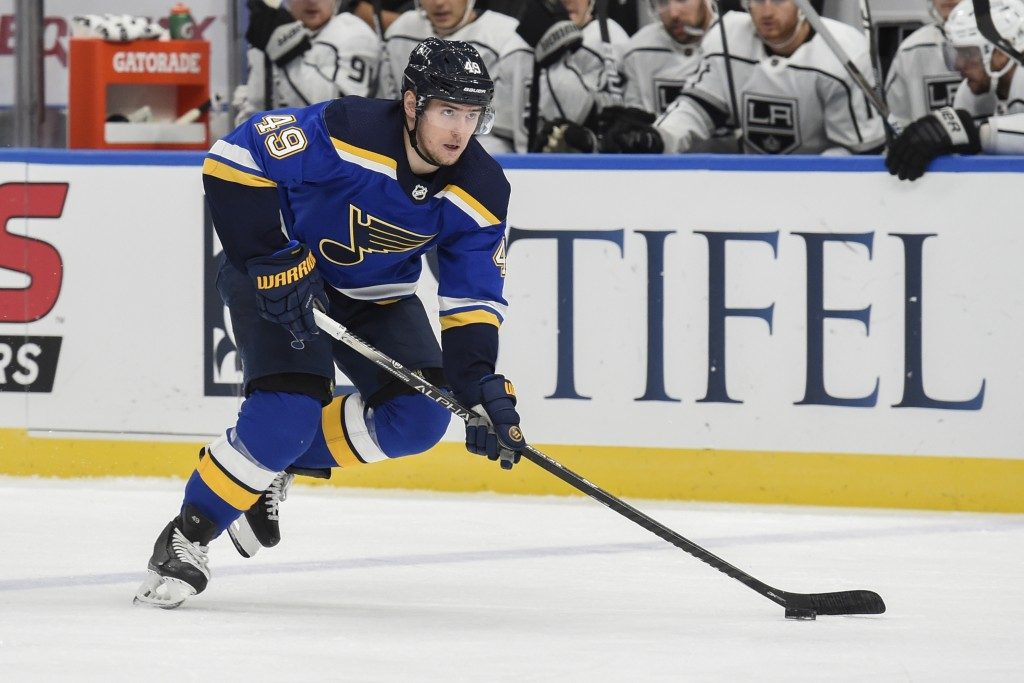 FILE - St. Louis Blues' Ivan Barbashev (49) handles the puck against the Los Angeles Kings during the first period of an NHL hockey game in Los Angele...