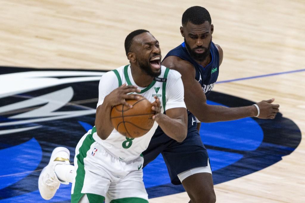 Boston Celtics guard Kemba Walker (8) reacts after being fouled by Dallas Mavericks forward Tim Hardaway Jr. during the first half of an NBA basketbal...
