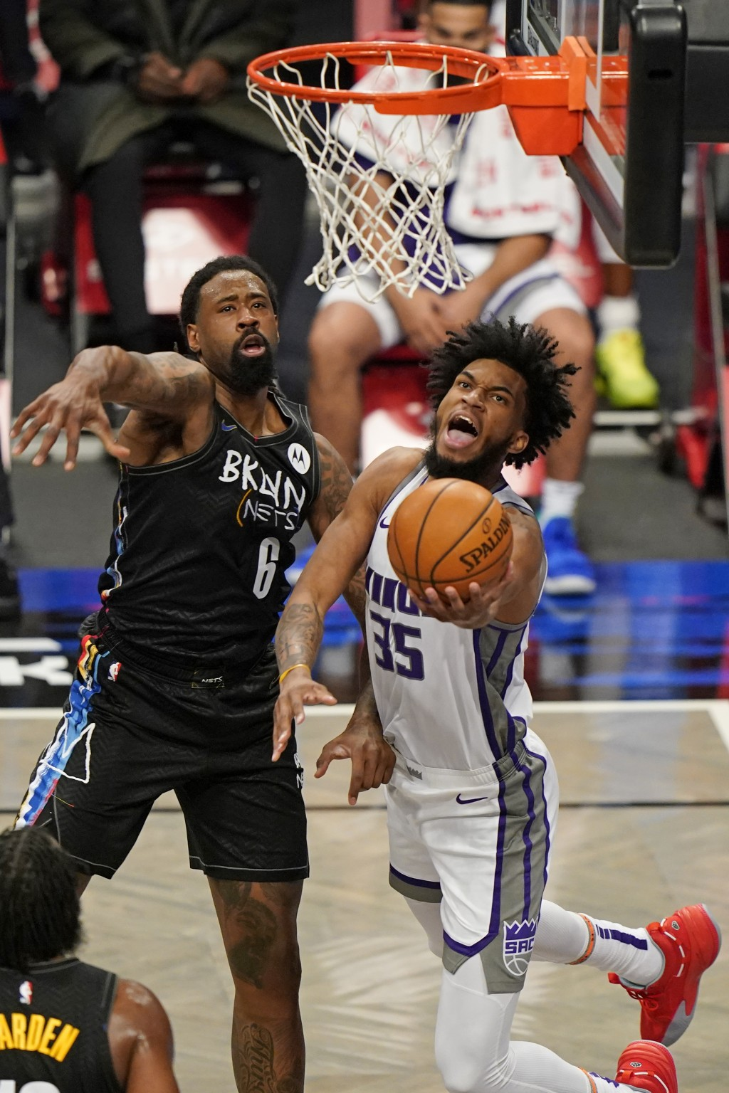Brooklyn Nets center DeAndre Jordan (6) defends Sacramento Kings forward Marvin Bagley III (35) as Bagley goes up for a layup during the first quarter...