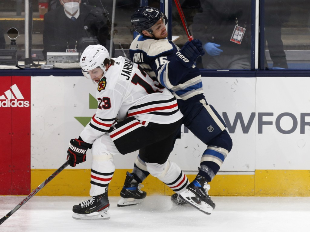 Columbus Blue Jackets forward Max Domi, right, collides with Chicago Blackhawks forward Mattias Janmark during the first period of an NHL hockey game ...