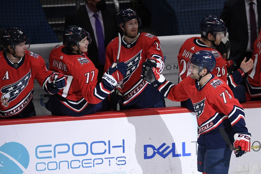 Washington Capitals left wing Conor Sheary (73) celebrates his goal with center Lars Eller (20), right wing T.J. Oshie (77) and center Nicklas Backstr...