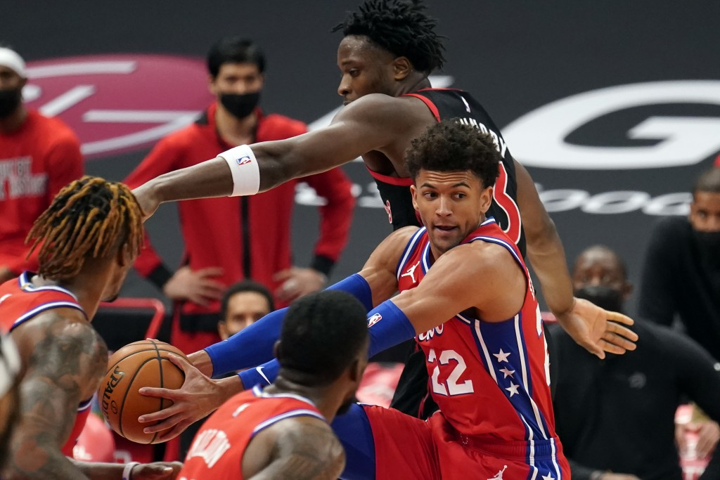 Philadelphia 76ers guard Matisse Thybulle (22) grabs a rebound away from Toronto Raptors forward OG Anunoby (3) during the first half of an NBA basket...