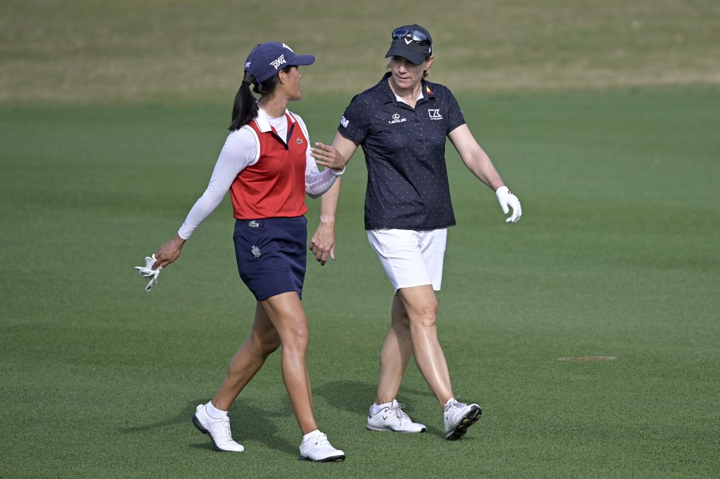 FILE - In this Sunday, Jan. 24, 2021 file photo, Celine Boutier, left, of France, and Annika Sorenstam, of Sweden, chat while walking down the 17th fa...