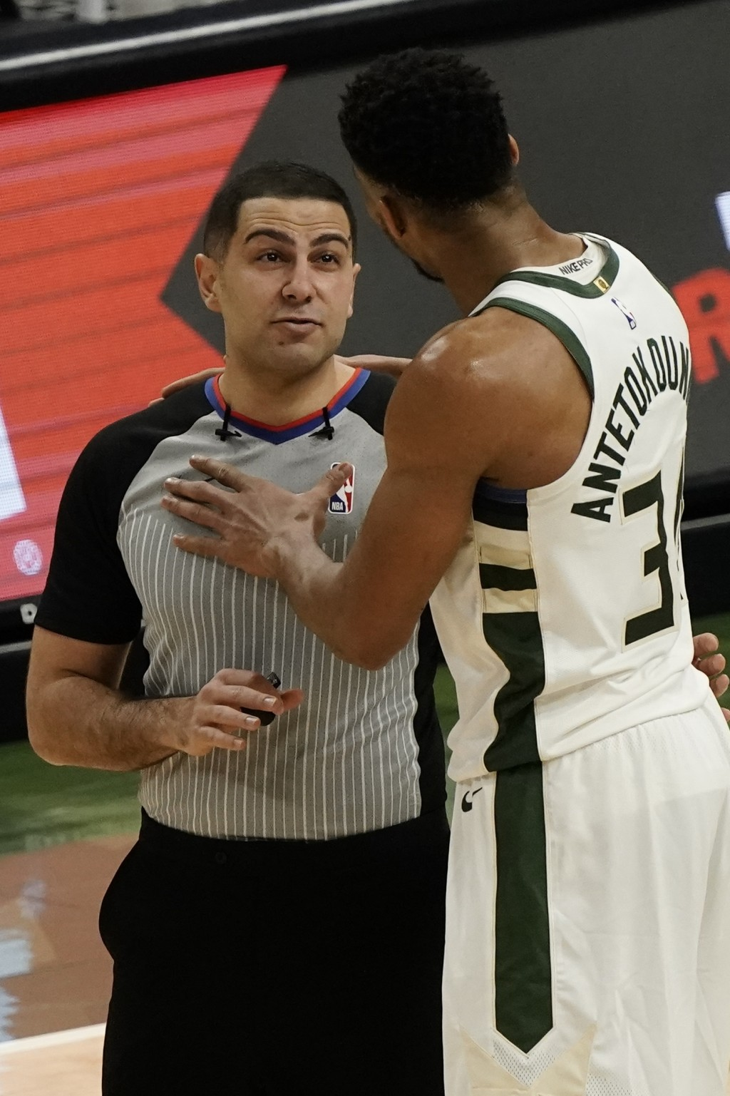 Milwaukee Bucks' Giannis Antetokounmpo argues a technical foul with referee Mousa Dagher (28) during the first half of an NBA basketball game against ...