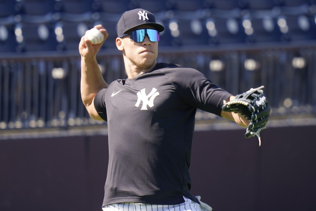New York Yankees' Aaron Judge takes part in a drill during a spring training baseball workout Tuesday, Feb. 23, 2021, in Tampa, Fla. (AP Photo/Frank F...