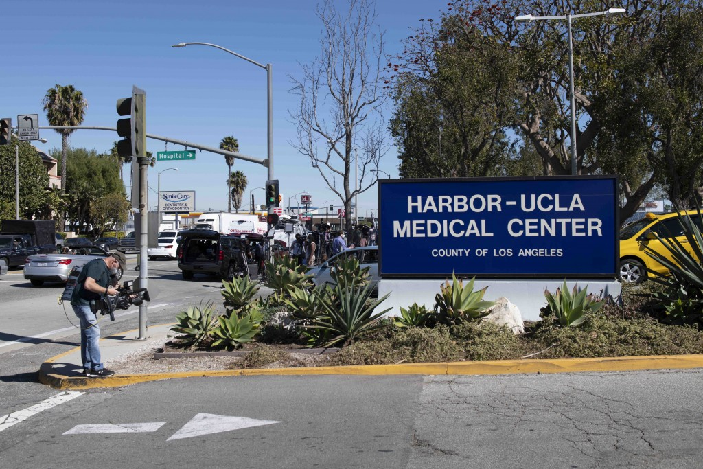 Members of the media gather outside an entrance to Harbor-UCLA Medical Center, Tuesday, Feb. 23, 2021, in Torrance, Calif., where golfer Tiger Woods w...