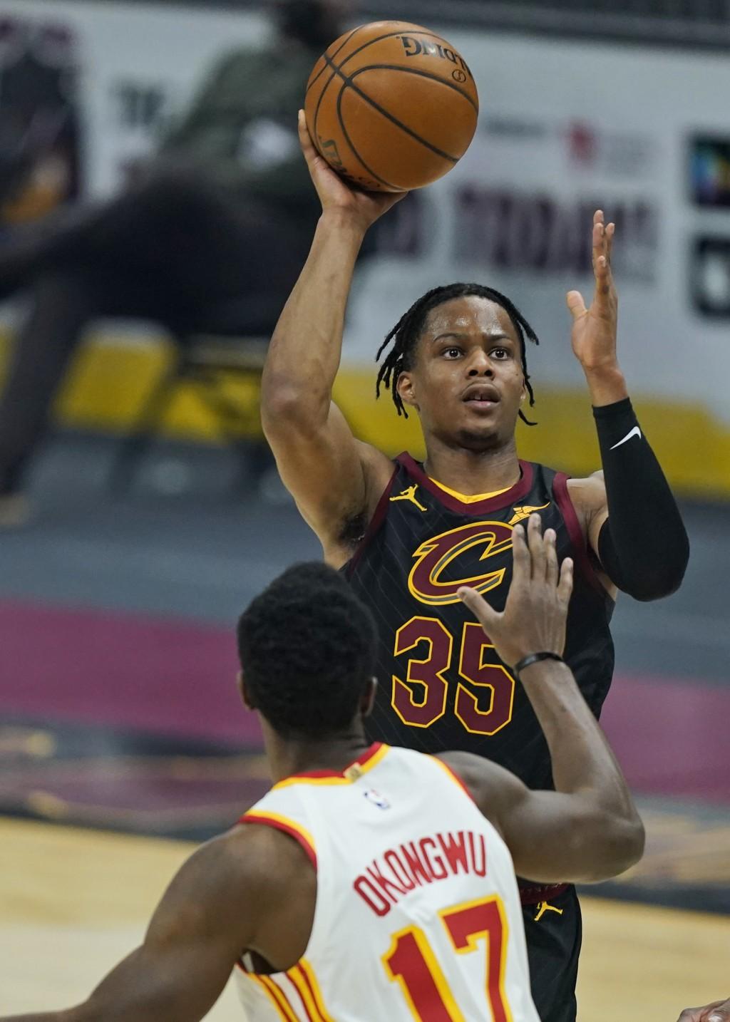 Cleveland Cavaliers' Isaac Okoro (35) shoots over Atlanta Hawks' Onyeka Okongwu (17) in the first half of an NBA basketball game, Tuesday, Feb. 23, 20...