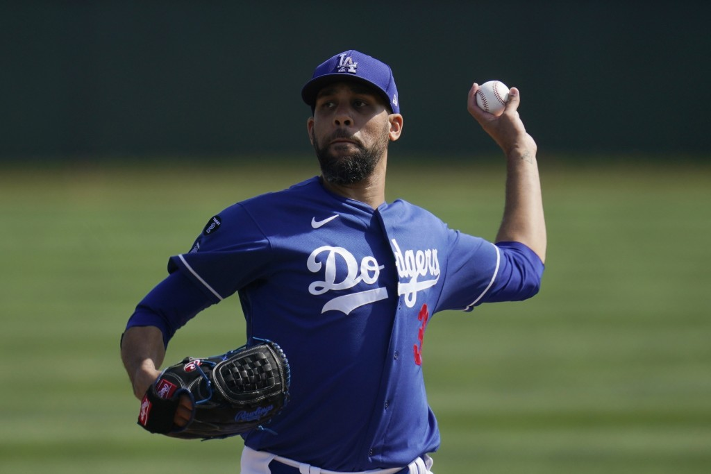 Los Angeles Dodgers starting pitcher David Price throws a mock pitch as pitchers take infield drills during a spring training baseball practice Tuesda...